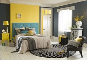 Head Board of bed against bright yellow in turquoise