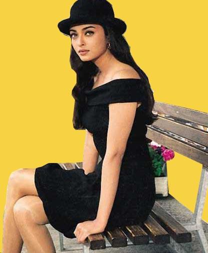 Aishwarya Rai in black and wearing a hat