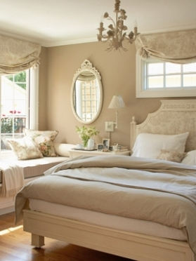 neutral-oasis-a-taupe-and-cream-color-palette-creates-a-calming-setting-painting-the-chandelier-and-mirror-frame-a-creamy-shade-helps-the-accents-blend-in-with-the-decor-beige-bedding-gives-the-room-a